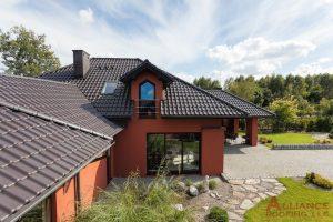 black tile roof on orange mansion