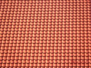 close up of orange ceramic tile
