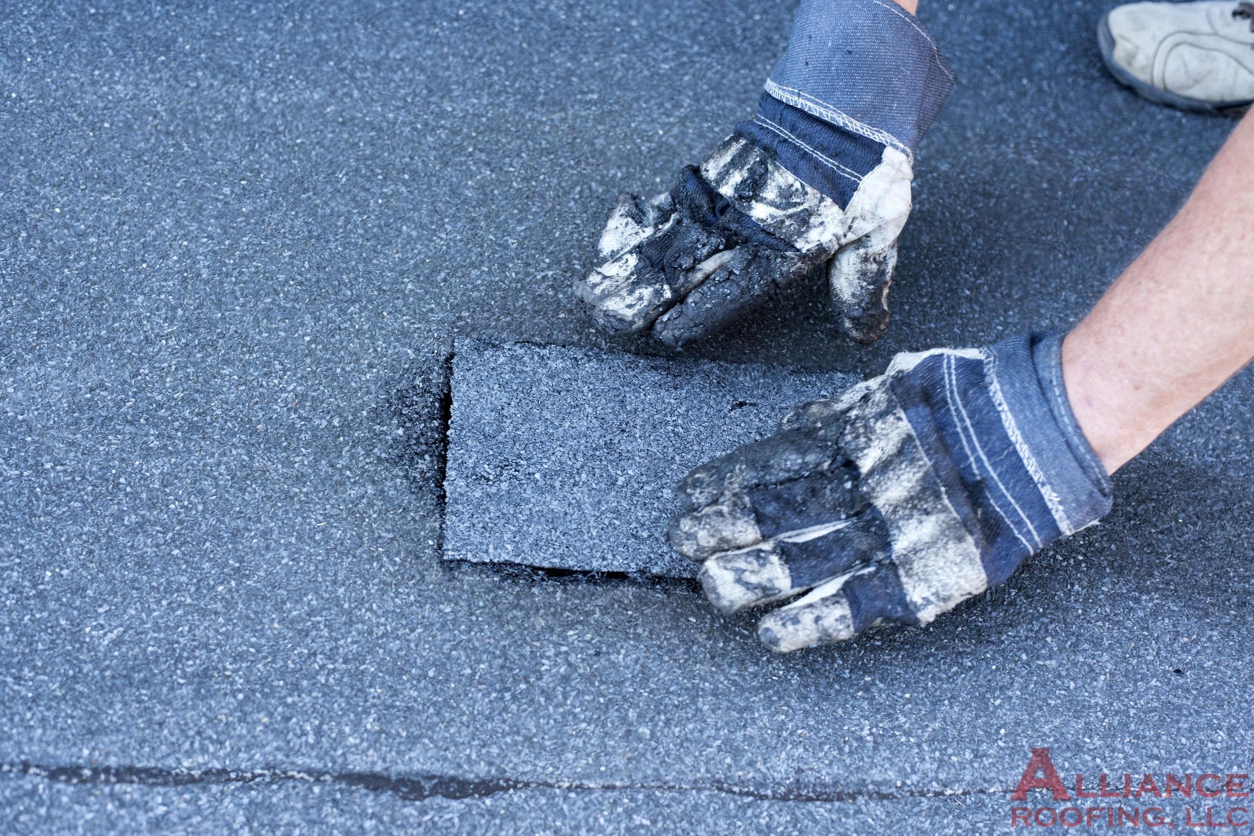 roofer installs modified bitumen roof