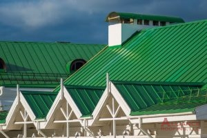 green standing seam commercial roof of a hotel