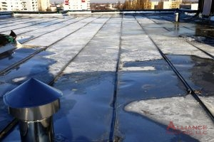 flat metal roof with pooled water