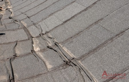 flat roof damaged and warped