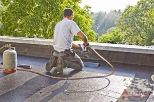roofer repairs flat commercial roof