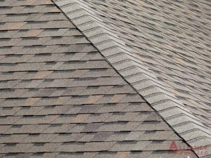 close up of roof shingles on edgle of roof